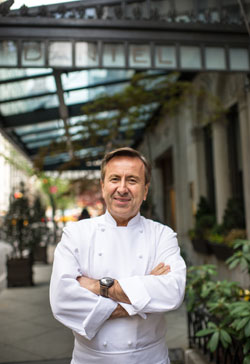 Boulud posing in front of his eponymous restaurant Daniel (photo by Daniel Krieger)