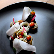 Oxheart in Houston: Purple kohlrabi, raw and pickled in oat's whey, vegetable ash, hazelnuts