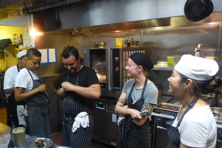 Brendan Collins and his culinary team plating up in the kitchen at Birch restaurant in Hollywood