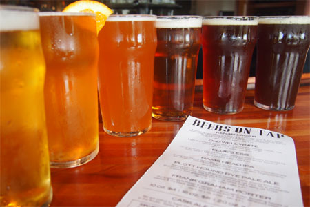 Outstanding beers draw crowds to Top of the Hill, one of GAYOT's Top 10 Brewpubs in the U.S.