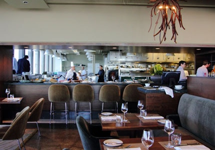 The dining room and kitchen at Canoe in Toronto