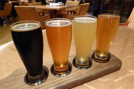A flight of beers from Eats Kitchen & Bar, one of the Top 10 Happy Hour Restaurants in Orange County, CA