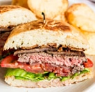 The popular First Base burger from Hopscotch, one of GAYOT's Top 25 Hottest Restaurants in San Francisco