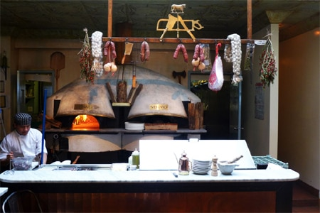 The wood-burning ovens at Tavola, one of GAYOT's Best Italian Restaurants in New York