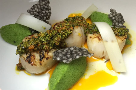 Chef Olivier Quignon presents artful dishes such as sea scallops at Avec Nous
