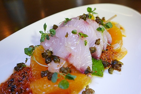 Canon Club's hamachi crudo is a sweet and spicy creation with fried capers, togarashi, fennel and orange salad