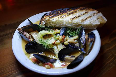 Hatchet Hall in Culver City serves up rustic American fare such as Penn Cove mussels with lamb sausage, flageolet beans, tomato fennel and Sherry