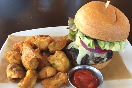 Pair HopSaint Brewing Company's juicy burger with house-brewed beers