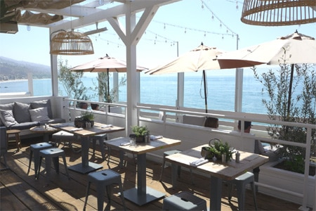 Enjoy a meal right on the beach at Malibu Farm Restaurant & Bar