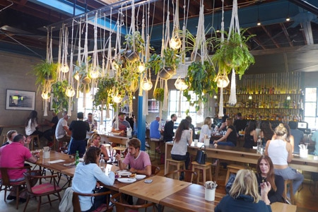 Communal tables and the bar at Rose Café-Restaurant, one of GAYOT's 25 Best Los Angeles Restaurants for Winter 2016