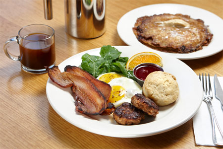 The 2x2x2 breakfast plate at Salt's Cure in Hollywood is loaded with eggs, griddlecakes and bacon or sausage