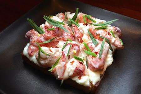 Lobster and burrata toast from SMYC, one of GAYOT's Top 10 Seafood Restaurants in Los Angeles