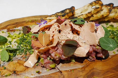 Indulge in Wagyu steak tartare with foie gras and truffle-tarragon mayonnaise at Wally's Beverly Hills