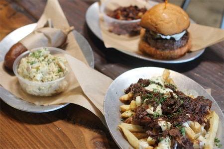 Working Class Kitchen's poutine and burger are made with Chianina beef from the restaurant group's exclusive herd