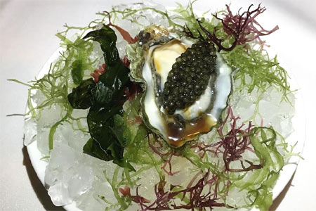 An oyster with caviar at Bourbon Steak in Glendale