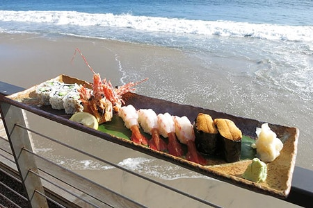Enjoy sushi and ocean views at Nobu Malibu, one of GAYOT's Top 10 Beachside Restaurants in Los Angeles