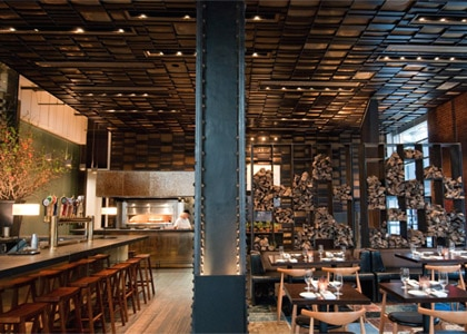 The bar and dining room of Colicchio & Sons in New York, one of Gayot's Top 10 New Restaurants in the United States