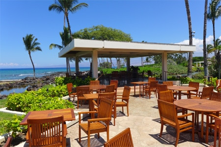 The open-air deck at CanoeHouse at the Mauna Lani Bay Hotel & Bungalows makes it one of the Best Outdoor Dining Restaurants in Hawaii