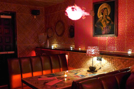 Sip a tropical cocktail at Bootlegger Tiki, one of GAYOT's Top 10 Lounges in Palm Springs