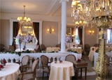 The dining room of Restaurant Lasserre, one of our Top 10 French Restaurants in Paris