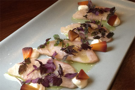 Yellowtail crudo is punctuated with pickled plum at SMYC (Santa Monica Yacht Club), one of GAYOT's Top 10 Seafood Restaurants in Los Angeles, CA
