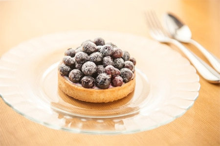 A blueberry tart is among the familiar desserts at Bon Marché Brasserie & Bar