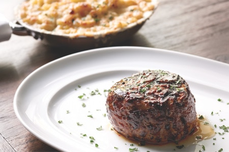 Indulge in a steak and a side of macaroni and cheese at Mastro's Steakhouse, one of GAYOT's Top 10 Steakhouses in Los Angeles