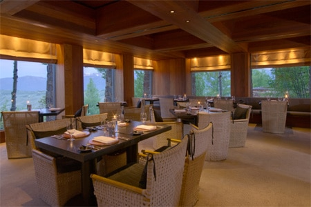 American cuisine in a rustic dining room overlooking the Teton Mountain range.
