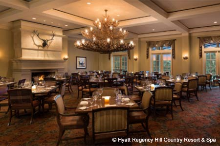 A hunting lodge atmosphere, complete with horn chandeliers, bolsters a menu featuring game, grits and local greens.
