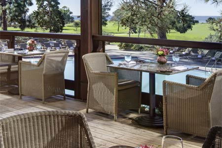 Sophisticated dining at The Lodge at Torrey Pines with views of the famous golf course.