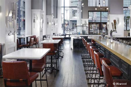 The Alise Chicago's restaurant showcases American cuisine and a view of State Street.