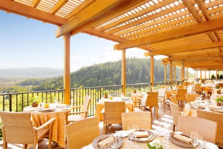 Sip wine and watch the sunset on Auberge du Soleil's romantic deck overlooking Napa Valley.