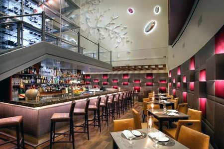 The talk of the town, Aureole's tower has raised the bar in Las Vegas for wine aficionados.