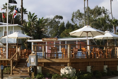 Enjoy a meal on the beachside patio at The Beachcomber at Crystal Cove