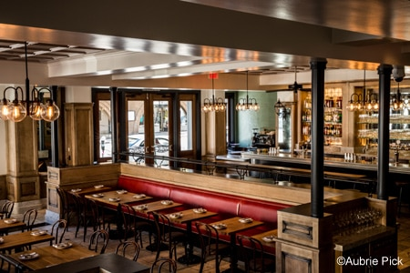 The interior of Belga is welcoming and comfortably European, replete with gas lamps, warm woods and cherry leather seats