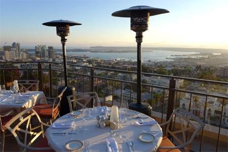 Enjoy skyline views from the terrace at Mister A's, one of GAYOT's Best Outdoor Dining Restaurants in San Diego
