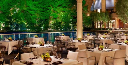 Take in lake views on the sprawling patio at SW Steakhouse, one of GAYOT's Best Outdoor Dining Restaurants in Las Vegas, NV