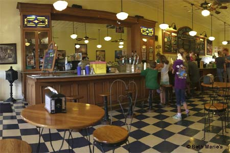 Old-timey ice cream parlor with malts, shakes and sundaes captures soda fountain experience in the heart of Denton Square.