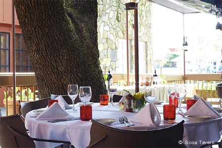 Enjoy a meal on the patio at Boca Tavern in Novato, one of GAYOT's Best Outdoor Dining Restaurants in Marin County