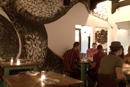 A giant rattlesnake mural slithers across the walls at Cascabel in Toluca Lake