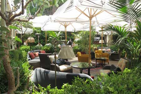 Enjoy a meal on the patio at Chateau Marmont Restaurant, one of GAYOT's Best Outdoor Dining Restaurants in West Hollywood