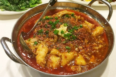Boiled sliced fish in hot sauce arrives in a massive bowl with a rich broth at Chengdu Taste 2 in Rosemead