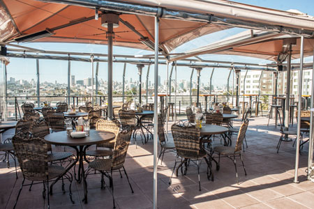 Savor tropical cocktails, imaginative bites and city views on the patio at El Techo de Lolinda in San Francisco