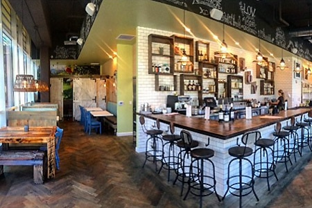 Savor organic vegan fare, cold-pressed juices and produce-driven cocktails at eLOVate Vegan Kitchen & Juicery in Santa Monica
