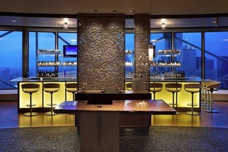 One of GAYOT's Top 10 View Restaurants in Dallas, Five Sixty by Wolfgang Puck offers 360-degree views of the city