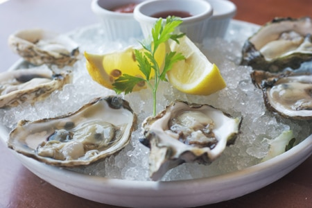 The quality of the seafood justifies dealing with the coastal crowds at Fly-N-Fish Oyster Bar & Grill in Orange County, CA