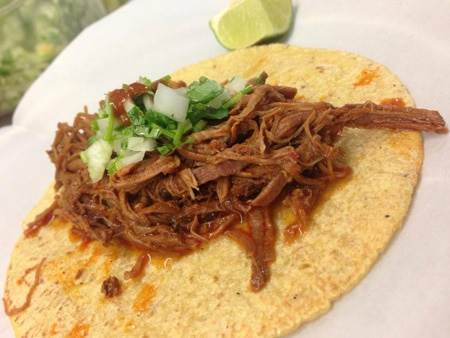 Savor gourmet stewed tacos at low prices at Guisados