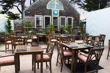 Enjoy a meal on the patio at Half Moon Bay Brewing Company, one of GAYOT's Best Outdoor Dining Restaurants in San Francisco's Peninsula