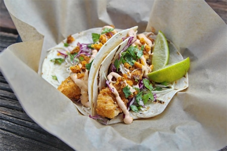 Enjoy fried chicken tacos at Huahua's Taqueria, one of GAYOT's Best Cheap Eats in Miami
