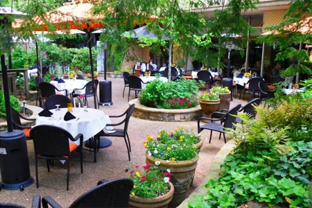 Enjoy a meal on the patio at La Grotta restaurant in Atlanta